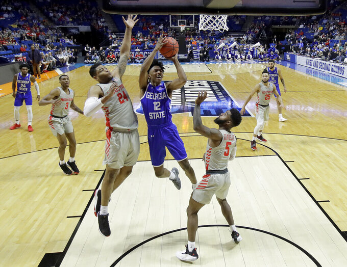 Georgia State's Kane Williams (12) shoots under pressure from Houston's Breaon Brady (24) and Corey Davis Jr. (5) during the first half of a first round men's college basketball game in the NCAA Tournament Friday, March 22, 2019, in Tulsa, Okla. (AP Photo/Charlie Riedel)