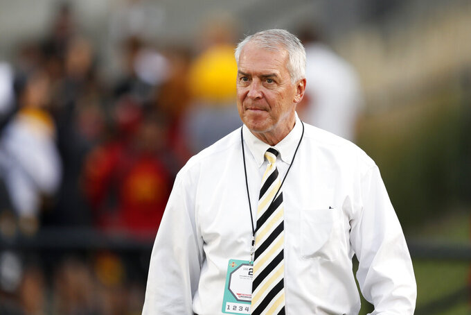FILE - In this Sept. 14, 2019, file photo, Iowa athletic director Gary Barta walks on the field before an NCAA college football game against Iowa State in Ames, Iowa. The University of Iowa said it would not pay a demand from eight Black former football players for $20 million in compensation for alleged racial discrimination they faced while they played for the Hawkeyes. The players also called for the firings of head football coach Kirk Ferentz, offensive line coach Brian Ferentz and Barta. (AP Photo/Charlie Neibergall, File)