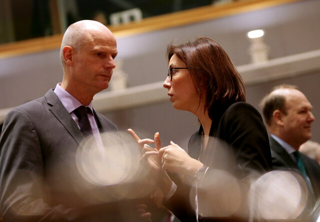 French Junior Minister for European Affairs Amelie de Montchalin, right, speaks with Dutch Foreign Minister Stef Blok during a meeting of EU General Affairs ministers at the European Council building in Brussels, Tuesday, Feb. 25, 2020. European Union ministers are putting the final touches on the mandate that will be the guide for EU negotiator Michel Barnier as he sits own with UK officials to thrash out a free trade deal over the next ten months. (AP Photo/Virginia Mayo)