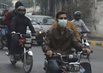 A motorcyclists wears face mask as heavy smog blankets Lahore, Pakistan, Thursday, Nov. 21, 2019. Amnesty International issues