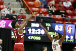 Stanford guard Daejon Davis (1) shoots over Washington State guard Ahmed Ali (23) during the second half of an NCAA college basketball game in Pullman, Wash., Saturday, Jan. 19, 2019. Stanford won 78-66. (AP Photo/Young Kwak)