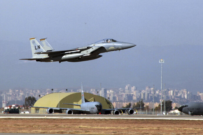 "FILE- In this Dec. 15, 2015, file photo, A U. S. Air Force F-15 fighter jet takes off from Incirlik Air Base near Adana, Turkey. Frayed U.S. relations with Turkey are raising a sensitive question rarely discussed in public: Should the United States remove the nuclear bombs it keeps at a Turkish air base? There is no known evidence that the weapons are at direct risk, but President Donald Trump has threatened to ""obliterate"" Turkey's economy if it does not halt its invasion of Syria, and some American arms control experts say the bombs would be safer elsewhere. (AP Photo)"