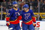 St. Louis Blues' David Perron, right, celebrates after scoring alongside teammate Alex Pietrangelo during the second period of an NHL hockey game against the Calgary Flames Thursday, Nov. 21, 2019, in St. Louis. (AP Photo/Jeff Roberson)