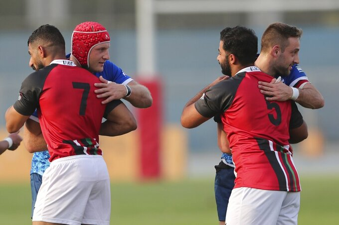 UAE and Israel rugby players celebrate with each other after a friendly match in Dubai, United Arab Emirates, Friday, March 19, 2021. (AP Photo/Kamran Jebreili)