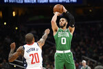 Boston Celtics forward Jayson Tatum (0) shoots over Washington Wizards guard Gary Payton II (20) during the second half of an NBA basketball game, Monday, Jan. 6, 2020, in Washington. The Wizards won 99-94. (AP Photo/Nick Wass)