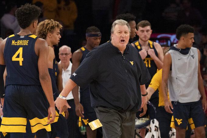 West Virginia head coach Bob Huggins yells during the second half of an NCAA college basketball game against St. John's, Saturday, Dec. 7, 2019 in New York. St. John's won 70-68. (AP Photo/Mark Lennihan)