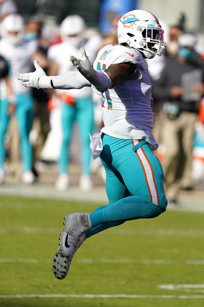 Miami Dolphins defensive end Emmanuel Ogbah (91) celebrates during the second half of an NFL football game against the San Francisco 49ers in Santa Clara, Calif., Sunday, Oct. 11, 2020. (AP Photo/Tony Avelar)