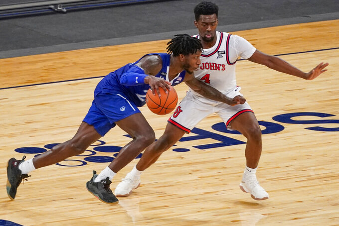 Seton Hall guard Myles Cale drives against St. John's guard Greg Williams Jr. (4) during the second half of an NCAA college basketball game in the quarterfinals of the Big East conference tournament, Thursday, March 11, 2021, in New York. (AP Photo/Mary Altaffer)