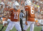 Texas quarterback Sam Ehlinger (11) celebrates with Joshua Moore (6) after a Texas touchdown against UTEP during the first quarter of an NCAA college football game Austin, Texas, Saturday, Sept. 12, 2020.  Ehlinger lost his top receiving targets from a year ago but has found plenty of options so far in 2020. The No. 8 Longhorns spread around seven touchdowns to seven different receivers in their first game. Now they go on the road to open Big 12 play against Texas Tech. (Ricardo B. Brazziell/Austin American-Statesman via AP)