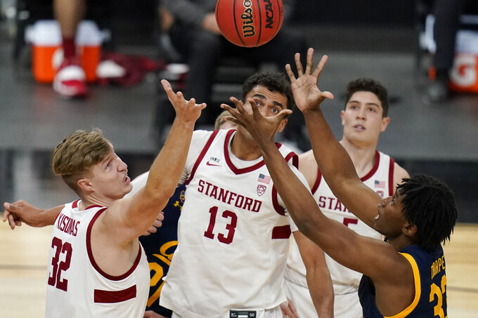 Stanford's Lukas Kisunas (32), Oscar da Silva (13) and California's D.J. Thorpe (33) vie for a rebound during the first half of an NCAA college basketball game in the first round of the Pac-12 men's tournament Wednesday, March 10, 2021, in Las Vegas. (AP Photo/John Locher)