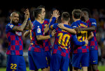 Barcelona's Lionel Messi celebrates after scoring a goal, during a Spanish La Liga soccer match between Barcelona and Alaves at Camp Nou stadium in Barcelona, Spain, Saturday, Dec. 21, 2019. (AP Photo/Joan Monfort)