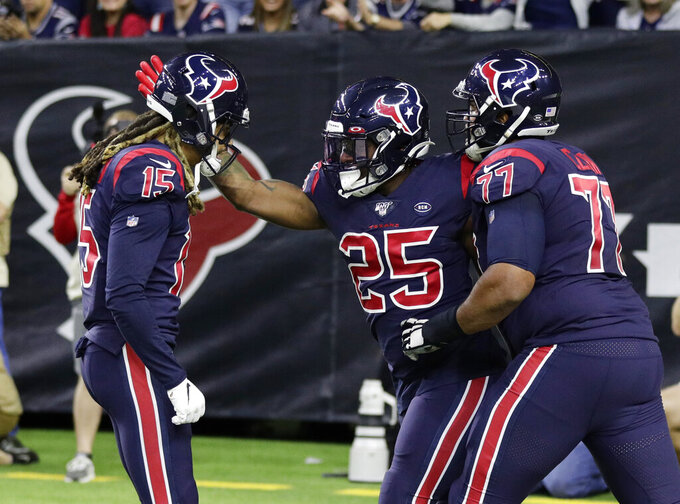 Houston Texans running back Duke Johnson (25) celebrates his touchdown against the New England Patriots with teammates during the first half of an NFL football game Sunday, Dec. 1, 2019, in Houston. (AP Photo/Mike Marshall)