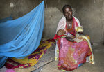 Letemariam, a mother of six, sits with her baby who was born in a former camp for Eritrean refugees now used by internally-displaced Tigrayans, after escaping fighting in her home town in western Tigray, in the Hitsats camp in the Tigray region of northern Ethiopia Saturday, Aug. 21, 2021. Letemariam was 7 months pregnant when her village was attacked and she and her five children fled on foot with only the clothes on their backs. (Claire Nevill/WFP via AP)