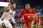 Houston's Justin Gorham (4) drives the ball around East Carolina's Jayden Gardner (1) during the first half of an NCAA college basketball game in Greenville, N.C., Wednesday, Jan. 29, 2020. (AP Photo/Karl B DeBlaker)