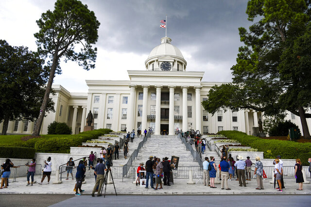 FILE - In this July 26, 2020, file photo,  mourners gathered at the Alabama Capitol following the death of Rep. John Lewis. Alabama voters will decide whether to remove racist, segregation-era language from the state's 1901 Constitution in the upcoming election. If approved, the measure would go back to legislators and another statewide vote. (AP Photo/Julie Bennett, File)