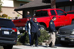 FBI agents leave the house of shooting suspect David Ian Long in Newbury Park, Calif., on Thursday, Nov. 8, 2018. Authorities said the former Marine opened fire at a country music bar in Southern California on Wednesday evening. (AP Photo/Jae C. Hong)