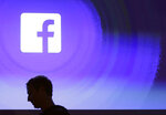FILE - In this April 4, 2013, file photo, Facebook CEO Mark Zuckerberg walks at the company's headquarters in Menlo Park, Calif. Facebook's plan to create a digital currency used across the world is already raising concern with financial regulators and privacy experts. (AP Photo/Marcio Jose Sanchez, File)