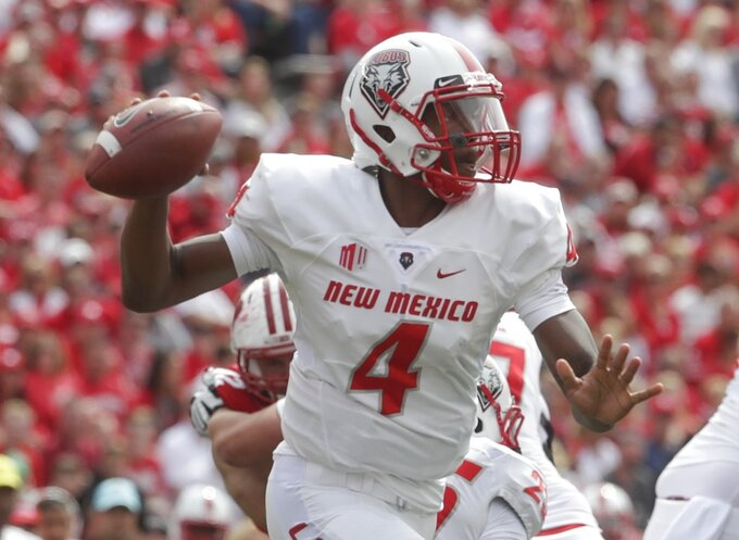 *New Mexico quarterback Sheriron Jones throws during the first half of an NCAA college football game against Wisconsin Saturday, Sept. 8, 2018, in Madison, Wis. (AP Photo/Morry Gash)