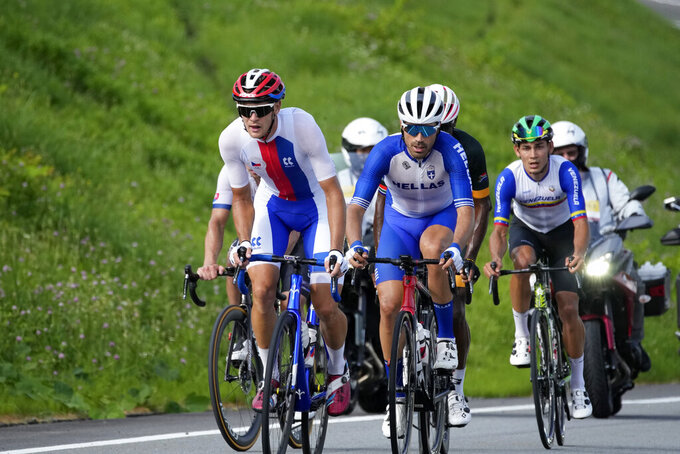 THIS CORRECTS TO ZDENEK STYBAR, NOT JURAJ SAGAN - Zdenek Stybar, left, of the Czech Republic, competes during the men's cycling road race at the 2020 Summer Olympics, Saturday, July 24, 2021, in Oyama, Japan. (AP Photo/Christophe Ena)