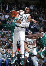 Michigan State's Xavier Tillman (23) pulls down a rebound against Eastern Michigan's Boubacar Toure, right, during the first half of an NCAA college basketball game, Saturday, Dec. 21, 2019, in East Lansing, Mich. (AP Photo/Al Goldis)