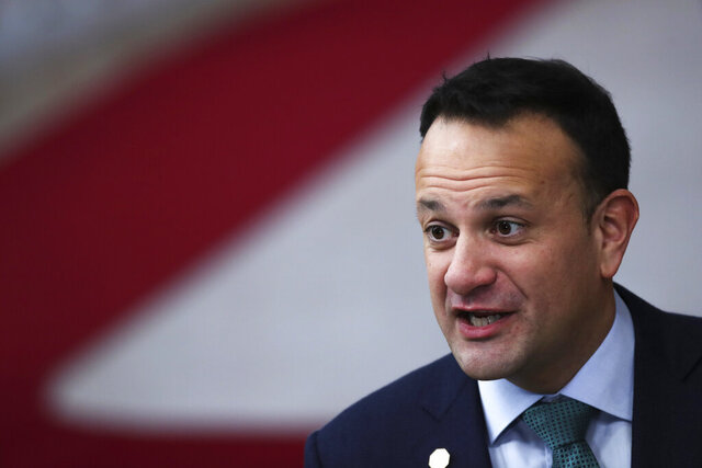 Irish Prime Minister Leo Varadkar speaks with the media as he arrives for an EU summit in Brussels, Friday, Dec. 13, 2019. European Union leaders are gathering Friday to discuss Britain's departure from the bloc amid some relief that Prime Minister Boris Johnson has secured an election majority that should allow him to push the Brexit deal through parliament. (AP Photo/Francisco Seco)