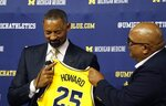 Juwan Howard reacts with tears of joys as he is introduced as Michigan's new men's NCAA college basketball coach by Director of Athletics Warde Manuel, Thursday, May 30, 2019 in Ann Arbor, Mich. The former member of the Fab Five has a five-year contract that will pay him $2 million in his first year. The former Miami Heat assistant coach replaces John Beilein, who left to coach the Cleveland Cavaliers. (AP Photo/Carlos Osorio)