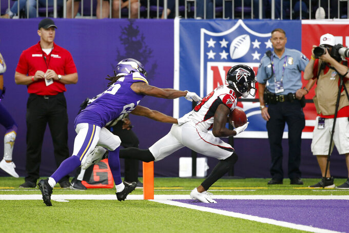 Atlanta Falcons wide receiver Calvin Ridley catches a 20-yard touchdown pass ahead of Minnesota Vikings cornerback Trae Waynes, left, during the second half of an NFL football game, Sunday, Sept. 8, 2019, in Minneapolis. (AP Photo/Bruce Kluckhohn)