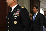 Defense Secretary Mark Esper arrives to brief members of the Senate on the details of the threat that prompted the U.S. to kill Iranian Gen. Qassem Soleimani in Iraq, Wednesday, Jan. 8, 2020 on Capitol Hill in Washington. (AP Photo/ Jacquelyn Martin)