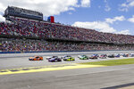 NASCAR Cup Series driver Joey Logano (22) leads the pack to the green flag during the Geico 500 NASCAR Sprint Cup auto race at Talladega Superspeedway Sunday, April 25, 2021 in Talladega, Ala. (AP Photo/Butch Dill)