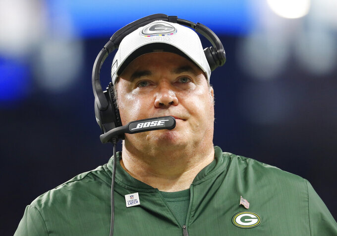 FILE - In this Oct. 7, 2018, file photo, Green Bay Packers coach Mike McCarthy watches the team's NFL football game against the Detroit Lions in Detroit. The Cleveland Browns didn't even talk to Mike McCarthy on their last coaching search. He was at the top of their list this time around. The former Green Bay coach is meeting Thursday, Jan. 2, 2020, with Browns owners Dee and Jimmy Haslam as Cleveland begins its latest quest to find the right coach after so many failed attempts. (AP Photo/Paul Sancya, File)