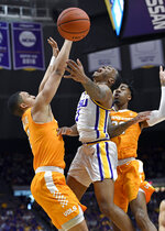 LSU guard Ja'vonte Smart (1) gets sandwiched between Tennessee forward Grant Williams, left, and guard Jordan Bowden, right, during the first half of an NCAA college basketball game, Saturday, Feb. 23, 2019, in Baton Rouge, La. (AP Photo/Bill Feig)