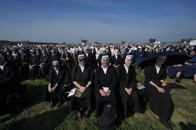Nuns attend a Mass celebrated by Pope Francis in the esplanade of the National Shrine in Sastin, Slovakia, Wednesday, Sept. 15, 2021. Pope Francis celebrated an open air Mass in Sastin, the site of an annual pilgrimage each September 15 to venerate Slovakia's patron, Our Lady of Sorrows. (AP Photo/Petr David Josek)