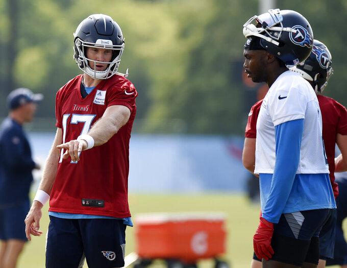 Tennessee Titans quarterback Ryan Tannehill (17) talks with wide receiver Julio Jones (2) during NFL football training camp Thursday, July 29, 2021, in Nashville, Tenn. (AP Photo/Mark Zaleski)