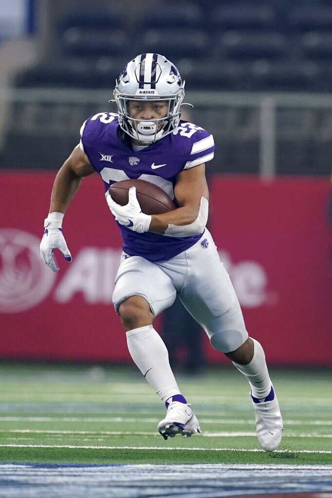 Kansas State running back Deuce Vaughn (22) sprints to the end zone for a touchdown in the first half of an NCAA college football game against Stanford in Arlington, Texas, Saturday, Sept. 4, 2021. (AP Photo/Tony Gutierrez)