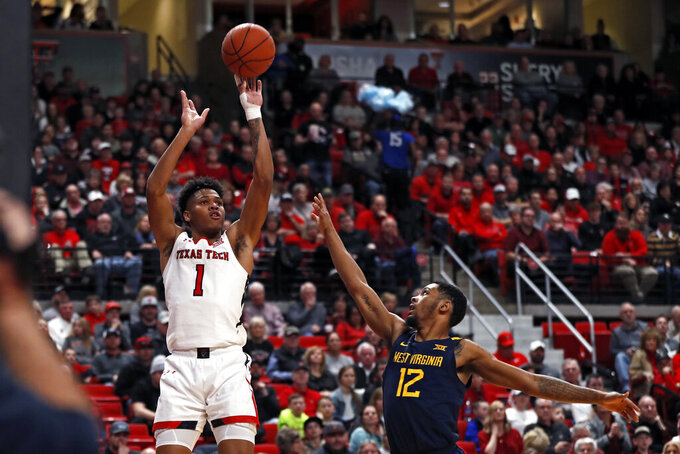 Texas Tech's Terrence Shannon Jr. (1) shoots the ball over West Virginia's Taz Sherman (12) during the first half of an NCAA college basketball game Wednesday, Jan. 29, 2020, in Lubbock, Texas. (AP Photo/Brad Tollefson)