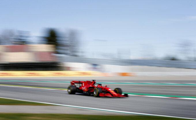 Ferrari driver Sebastian Vettel of Germany steers his car during the Formula One pre-season testing session at the Barcelona Catalunya racetrack in Montmelo, outside Barcelona, Spain, Thursday, Feb. 27, 2020. (AP Photo/Joan Monfort)