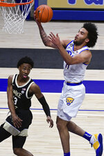 Pittsburgh forward Justin Champagnie drives to the basket against Wake Forest guard Quadry Adams during the first half of an NCAA college basketball game, Tuesday, March 2, 2021, in Pittsburgh. (AP Photo/Fred Vuich)