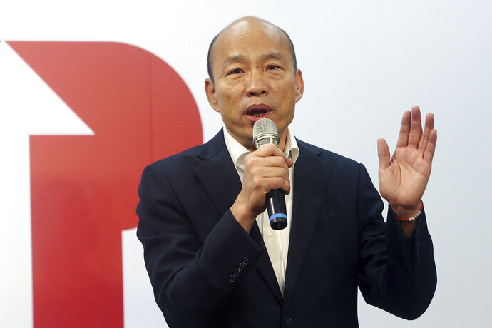 Han Kuo-yu of the Nationalist Party speaks during a media event announcing his campaign logo in Taipei, Taiwan, Thursday, Nov. 14, 2019. The China-friendly opposition candidate in Taiwan's upcoming presidential election is urging Hong Kong to adopt universal suffrage as the best way of stemming months of anti-government protests. (AP Photo/Chiang Ying-ying)