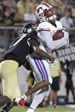 SMU wide receiver James Proche (3) catches a pass in the end zone for a 5-yard touchdown in front of Central Florida defensive back Richie Grant (27) during the first half of an NCAA college football game Saturday, Oct. 6, 2018, in Orlando, Fla. (AP Photo/Phelan M. Ebenhack)