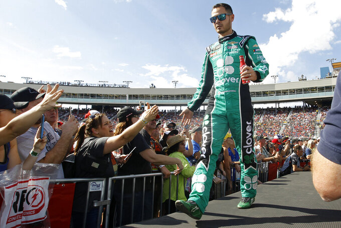 Kyle Larson greets fans during driver introductions prior to the NASCAR Cup Series auto race at ISM Raceway, Sunday, Nov. 10, 2019, in Avondale, Ariz. (AP Photo/Ralph Freso)