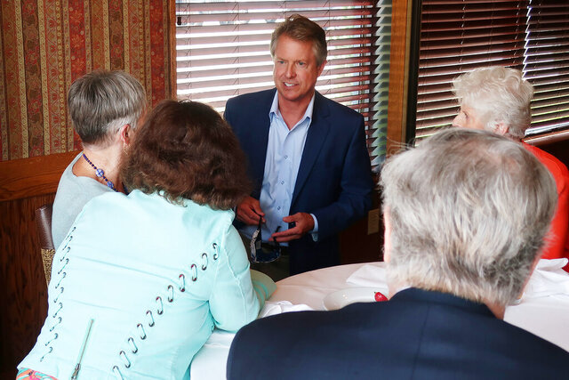 U.S. Rep. Roger Marshall, R-Kan., speaks to a local Elephant Club meeting in the banquet room of a restaurant in Overland Park, Kan., on Aug. 18, 2020. Marshall is running for an open U.S. Senate seat and gives President Donald Trump an A+ grade for his handling of the coronavirus pandemic. (AP Photo/John Hanna)
