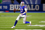 Buffalo Bills' Josh Allen (17) rushes during the first half of an NFL divisional round football game against the Baltimore Ravens Saturday, Jan. 16, 2021, in Orchard Park, N.Y. (AP Photo/Jeffrey T. Barnes)