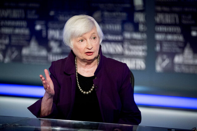 FILE - In this Aug. 14, 2019, file photo former Fed Chair Janet Yellen speaks with FOX Business Network guest anchor Jon Hilsenrath in the Fox Washington bureau in Washington. In her first year as Federal Reserve chair, Yellen presided over a policy panel divided over the issue of how much longer the central bank could afford to keep its benchmark interest rate at a record low, and how to prepare financial markets for the start of rate hikes. (AP Photo/Andrew Harnik, File)