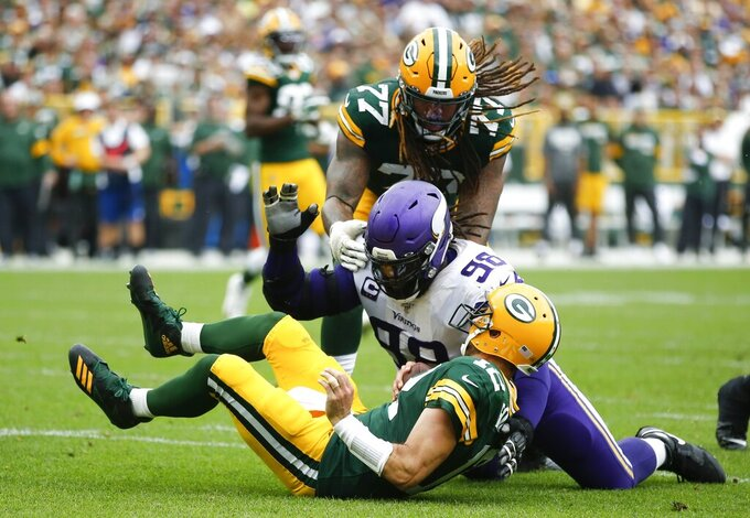 Minnesota Vikings' Linval Joseph sacks Green Bay Packers' Aaron Rodgers during the second half of an NFL football game Sunday, Sept. 15, 2019, in Green Bay, Wis. (AP Photo/Matt Ludtke)