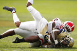 Georgia inside linebacker Monty Rice (32) tackles Georgia Tech wide receiver Ahmarean Brown (10) during the first half of an NCAA college football game Saturday, Nov. 30, 2019, in Atlanta. (Joshua L. Jones/Athens Banner-Herald via AP)
