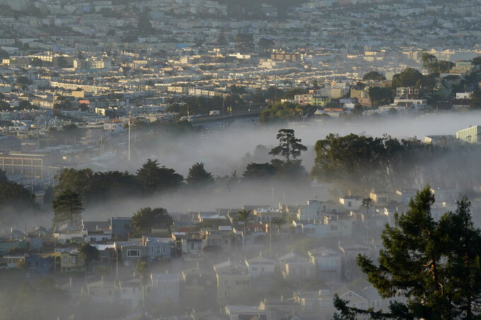 FILE - In this Oct. 20, 2020, file photo low-lying morning fog is shown over San Francisco. Rising inflation is expected to lead to a sizeable increase in Social Security's annual cost-of-living adjustment, or COLA, for 2022. Exactly how much will be revealed Wednesday morning after a Labor Department report on inflation during September, a data point used in the final calculation. (AP Photo/Jeff Chiu, File)