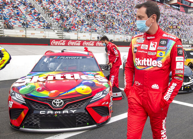 Kyle Busch walks around his car prior to the start of the Bass Pro Shops NRA Night Race Saturday at Brisol Motor Speedway. (David Crigger/Bristol Herald Courier via AP)