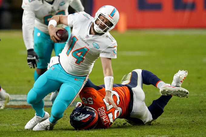Miami Dolphins quarterback Ryan Fitzpatrick (14) is tackled by Denver Broncos outside linebacker Bradley Chubb (55) during the second half of an NFL football game, Sunday, Nov. 22, 2020, in Denver. (AP Photo/David Zalubowski)