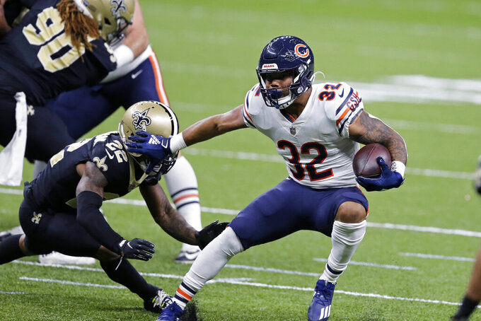 Chicago Bears running back David Montgomery (32) carries against New Orleans Saints free safety Chauncey Gardner-Johnson (22) in the first half of an NFL wild-card playoff football game in New Orleans, Sunday, Jan. 10, 2021. (AP Photo/Brett Duke)