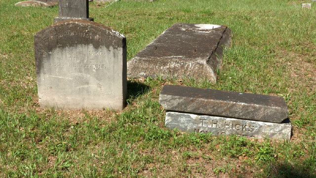 FILE- This June 27, 2019 photo, shows the grave of Caroline Hicks, at left, one of seven moved from the now-forgotten Zion Cemetery to Memorial Park, an African-American cemetery in Tampa, Fla. The Florida Senate set aside $100,000 in its budget proposal to erect memorials at Zion and Ridgewood cemeteries in Tampa. Both were African Americas cemeteries that were abandoned and in some cases the land was developed on top of burial sites.(James Borchuck/Tampa Bay Times via AP, File)/Tampa Bay Times via AP)
